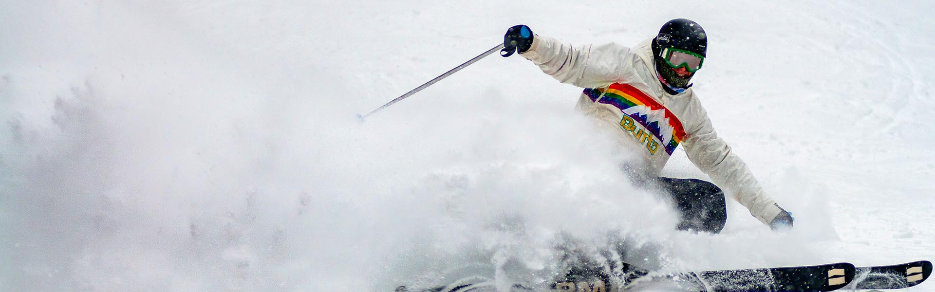 Image of skier creating snow spray