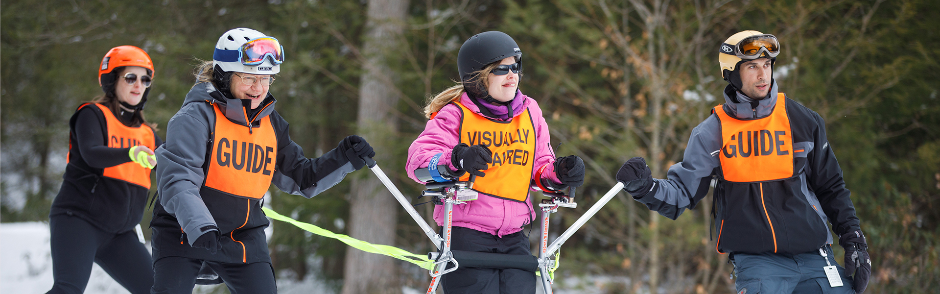 Image of STRIDE adaptive student with instructors on trail