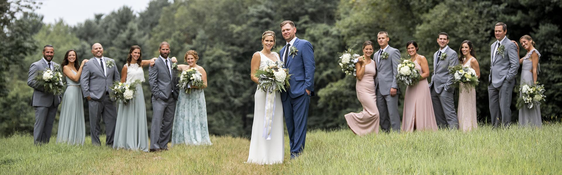 Wedding party couples posing in Ski Sundown field