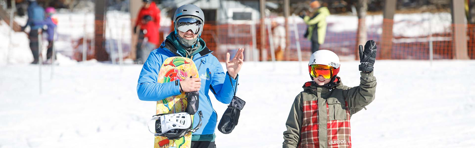 Snowboard instructor with student