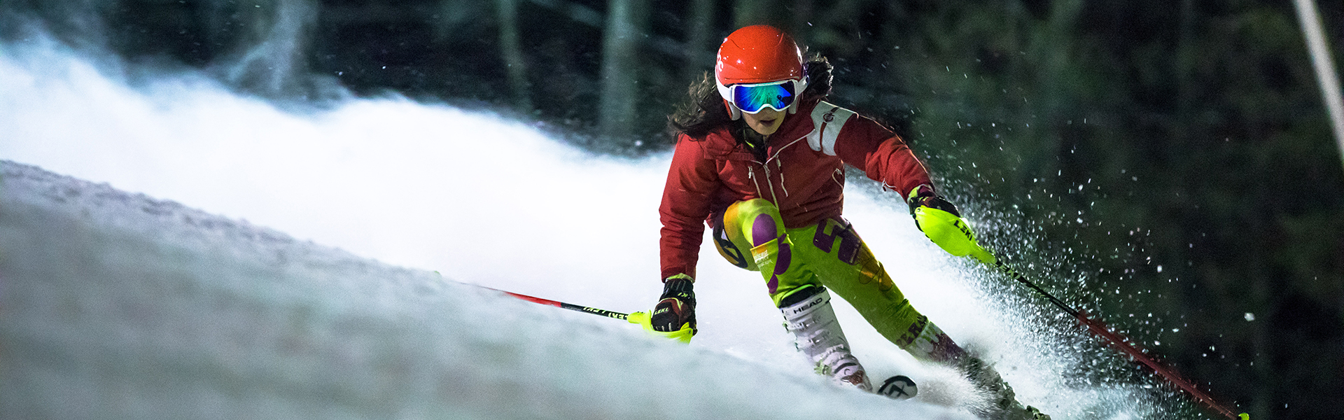 Girl skiing on NASTAR race course