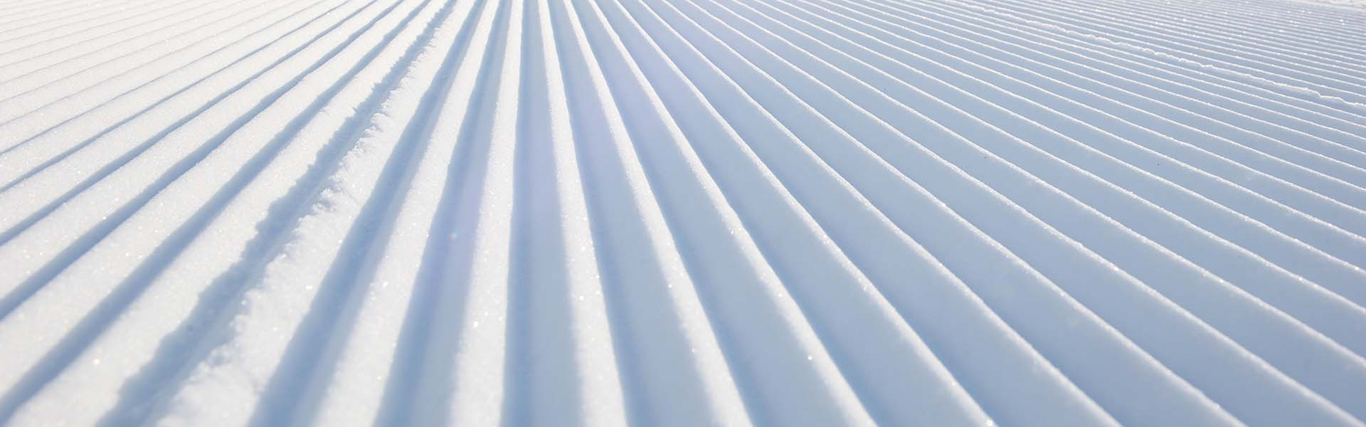 View of corduroy groom on Ski Sundown trail