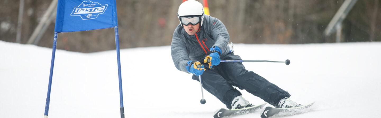 Skier on NASTAR race course