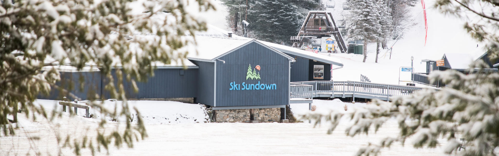Snowy view of Ski Sundown base lodge
