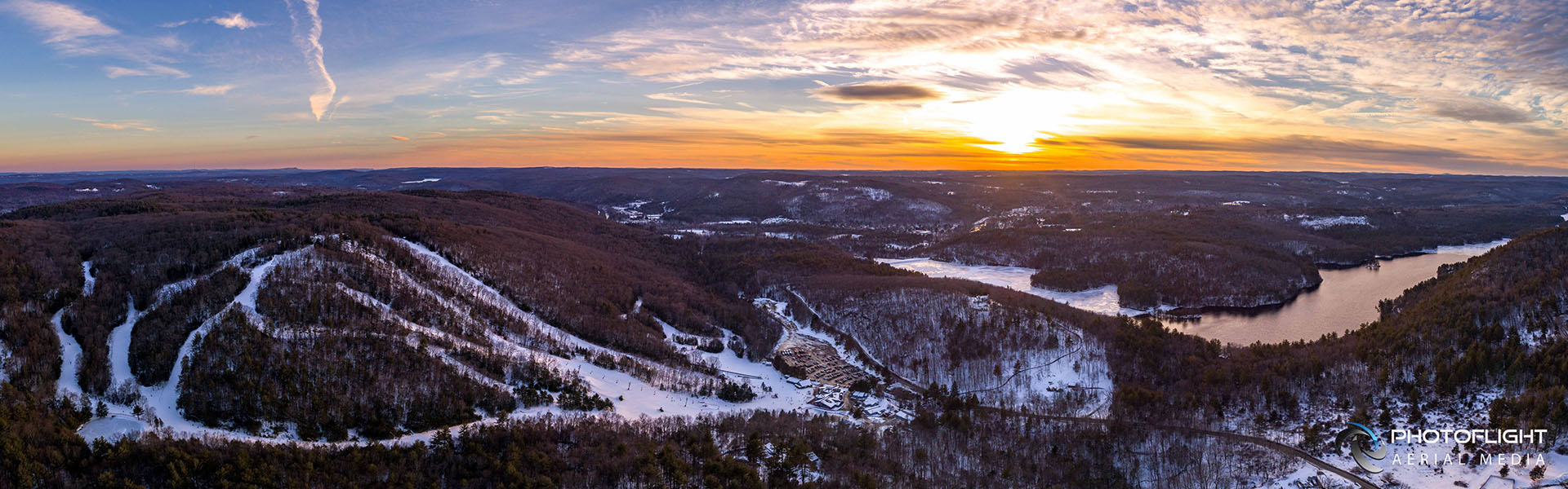 Drone image of Ski Sundown mountain at sunset