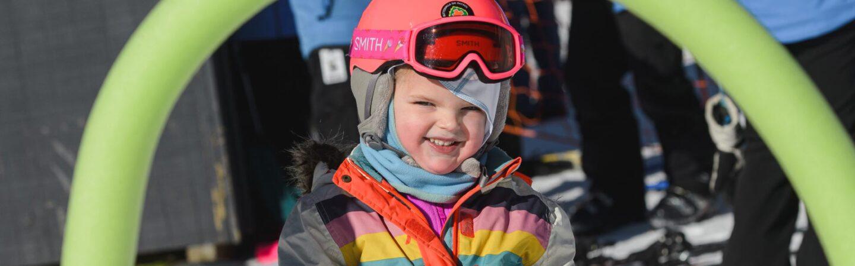 Girl in 3s on skis program