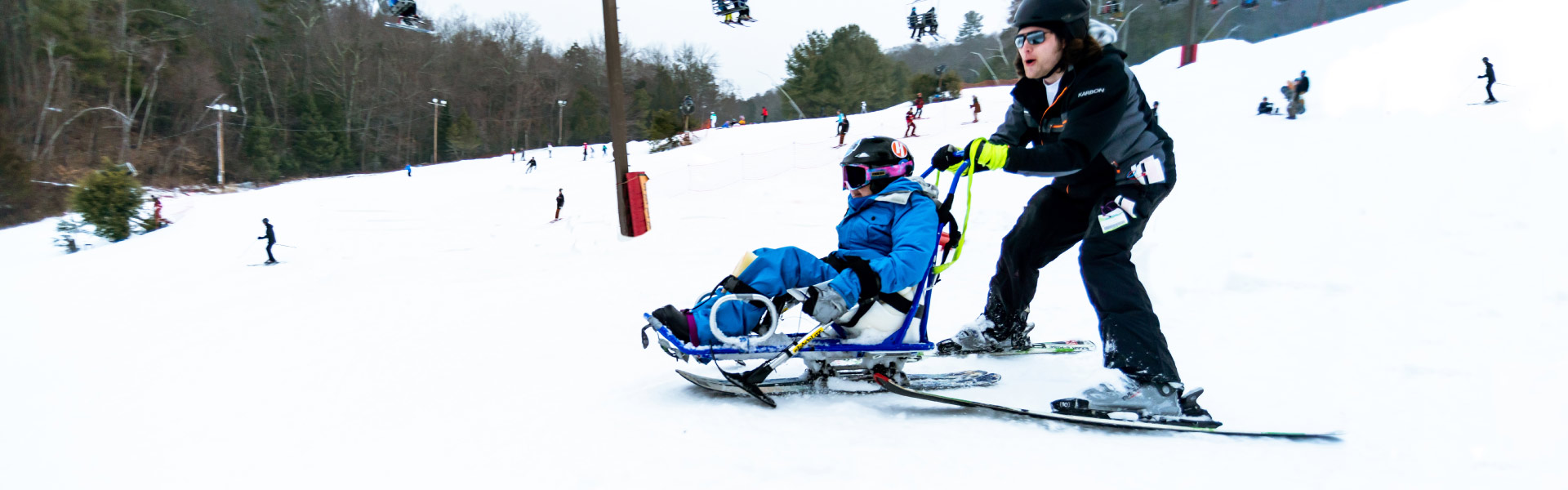 Adaptive Instructor and sit-ski student
