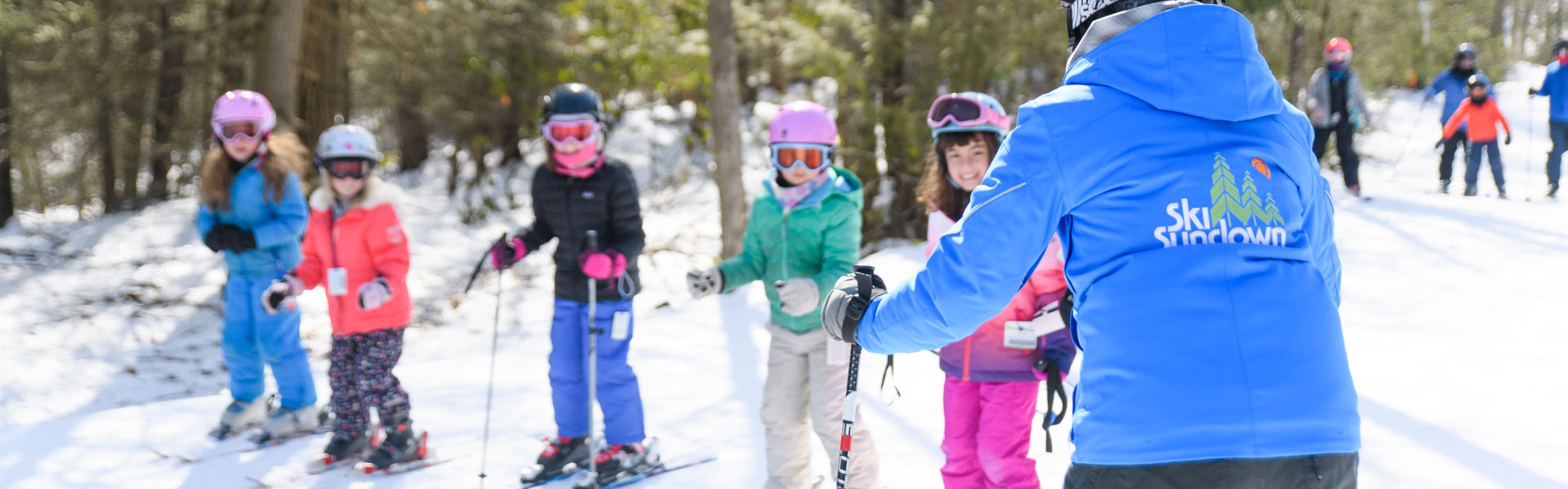 Instructor with a group of skiers