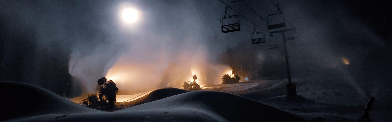 Snowmaking on mountain at night