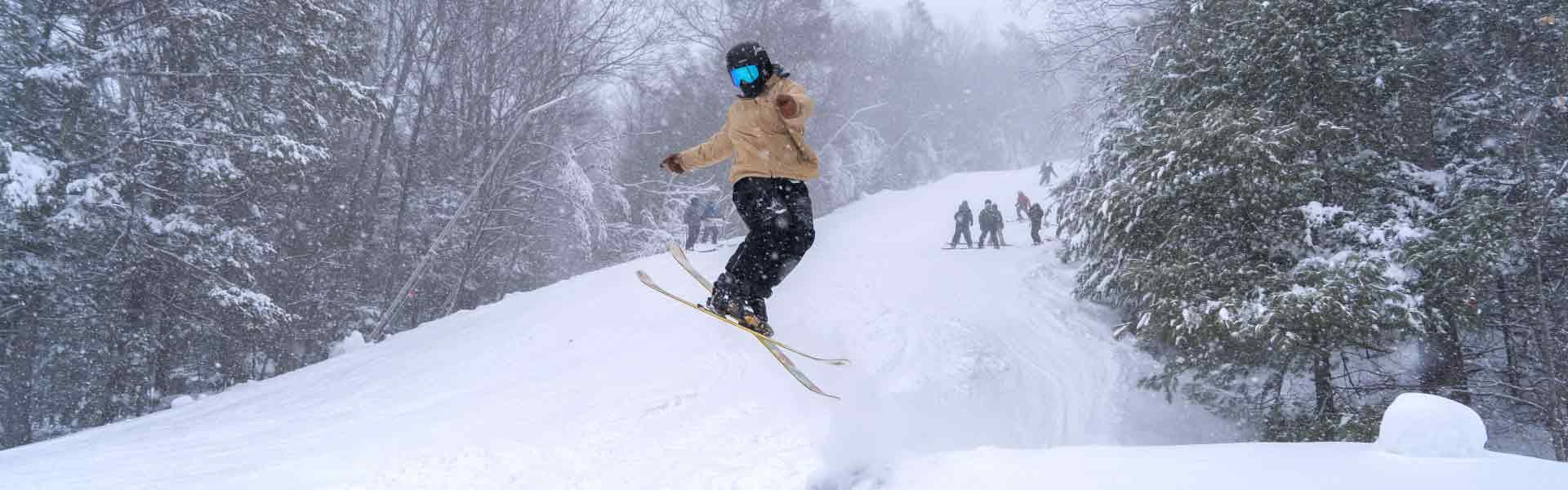 Skier jumping in terrain park