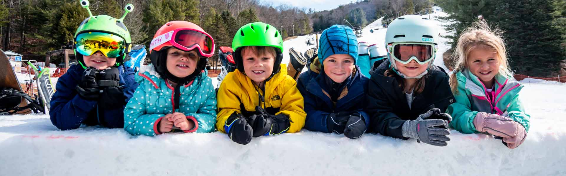 row of kids enjoying the mountain