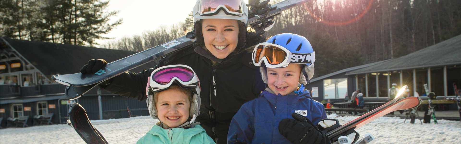 Mom and kids with skis